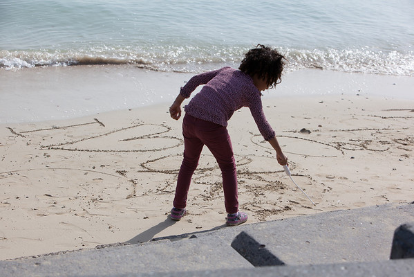 Qatar National Day girl writing in sand