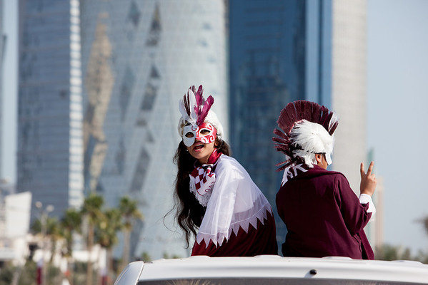 Qatar National Day kids on car roofs