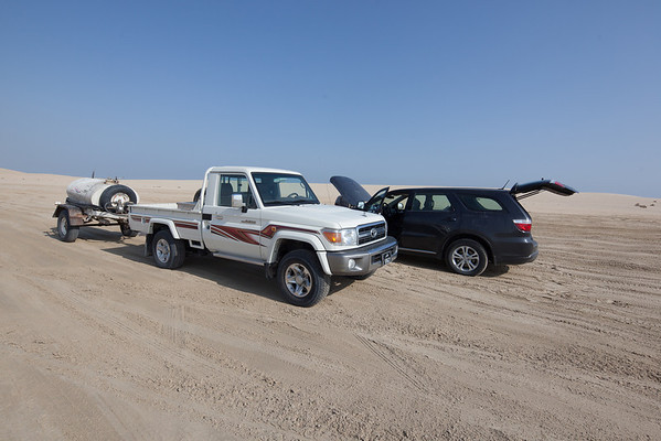 Car accident broken radiator grill cooler leak Qatar desert