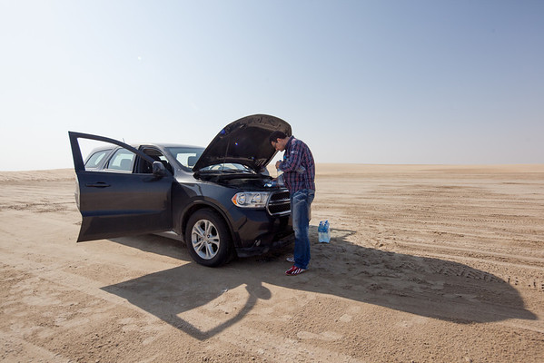 Car accident broken radiator grill desert Qatar