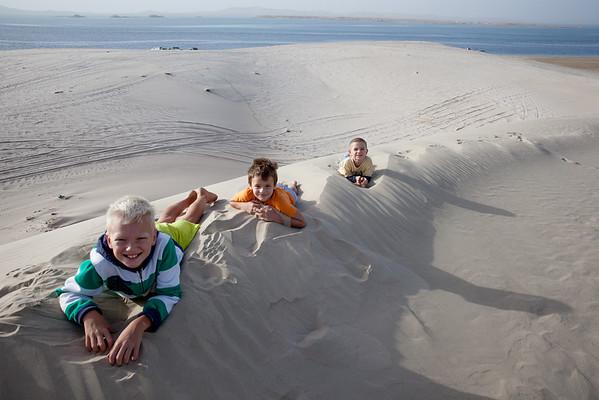 Kids dune bashing Qatar Inland Sea