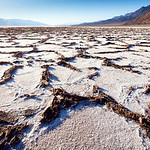 Salt crust at the bottom of the Badwater Basin, Death Valley. My wife was upset that I let my daughter walk with me in the heat. But Timi is tough... :-)